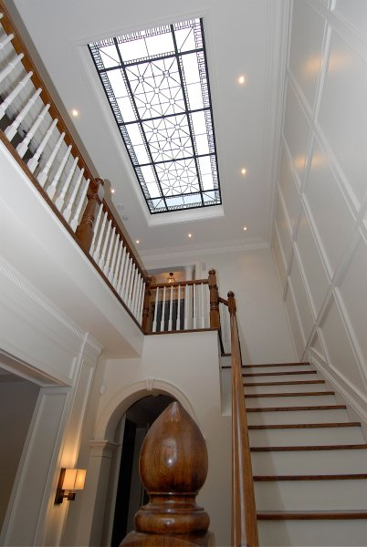 Stained and leaded glass skylight for the center hall and stair of a custom built residence in Toronto